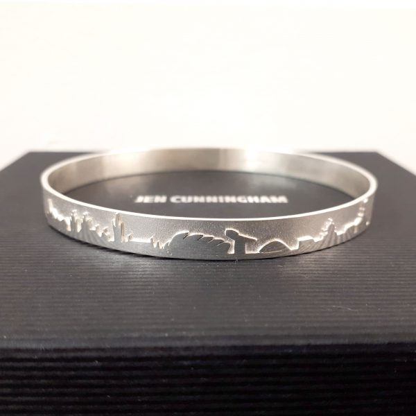 'Glasgow City Skyline Bangle - Sterling Silver' by artist Jen Cunningham