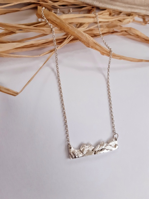 'Mountain Range II - Recycled Silver' by artist Jess MacDonald Brass